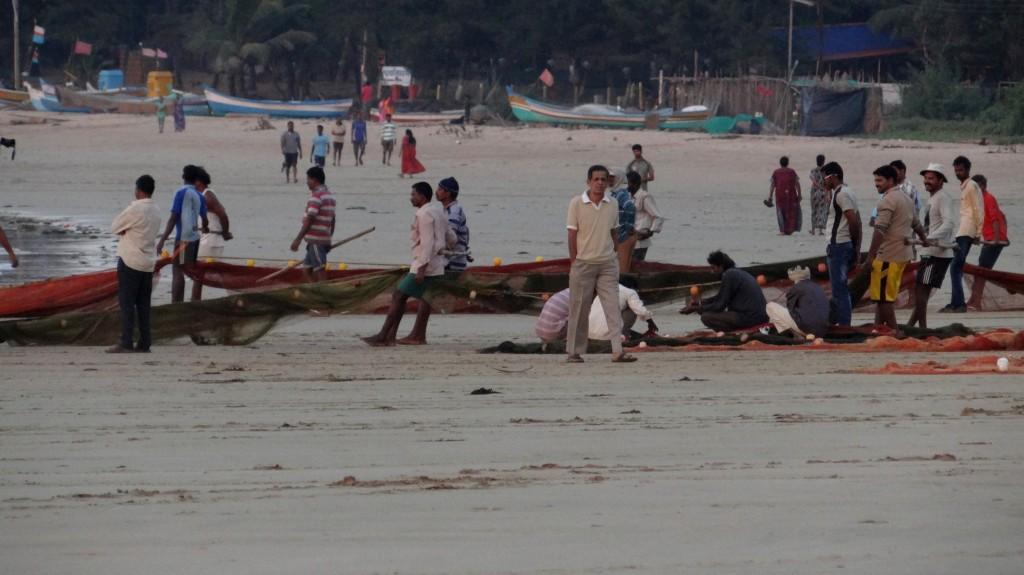 Fishermen pulling the net